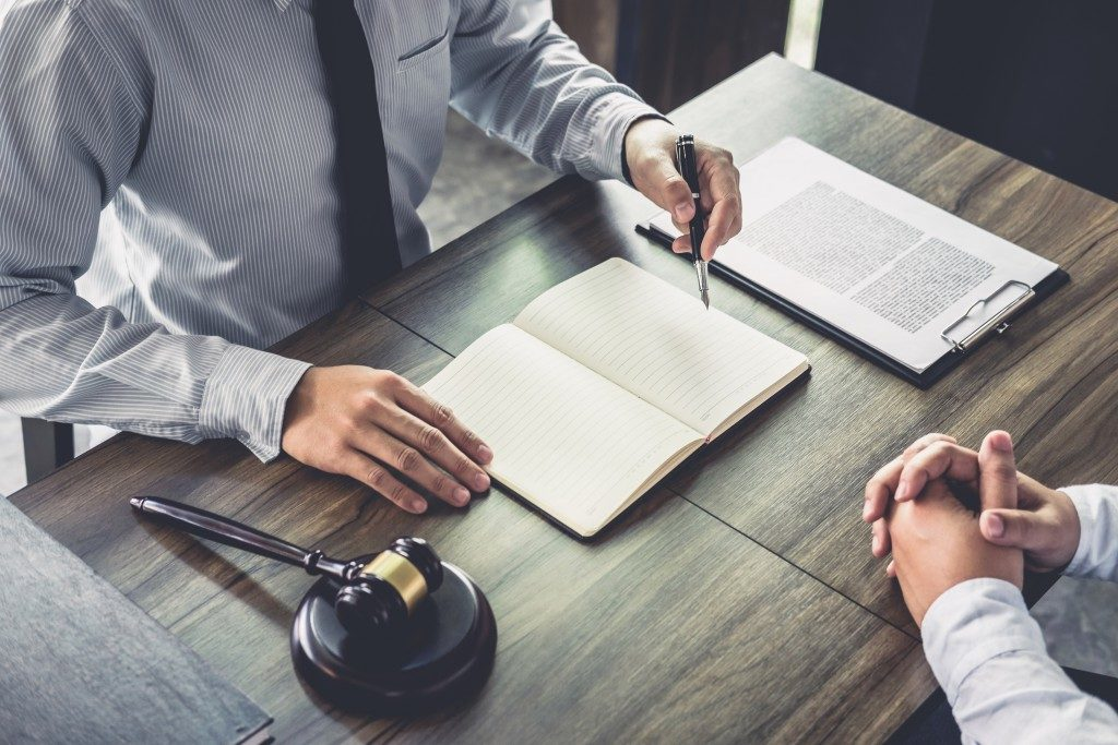 lawyer taking notes of client