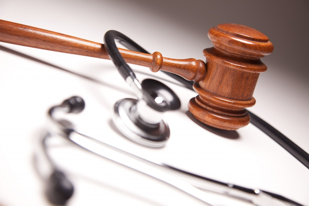 Gavel and Stethoscope on Gradated Background with Selective Focus